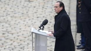 French President Francois Hollande speaks at the ceremony at Les Invalides