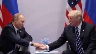 Vladimir Poutine e Donald Trump, num encontro à margem do G20
