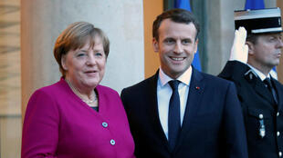 Friends reunited: German Chancellor Angela Merkel and French President Emmanuel Macron during their meeting on Friday