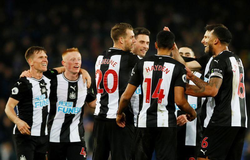wasu daga cikin 'yan wasan kungiyar kwallon kafa ta Newcastle United ta Ingila.
