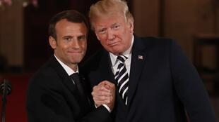French President Emmanuel Macron (L) clasps hands with US President Donald Trump at the White House in Washington, DC on April 24, 2018.