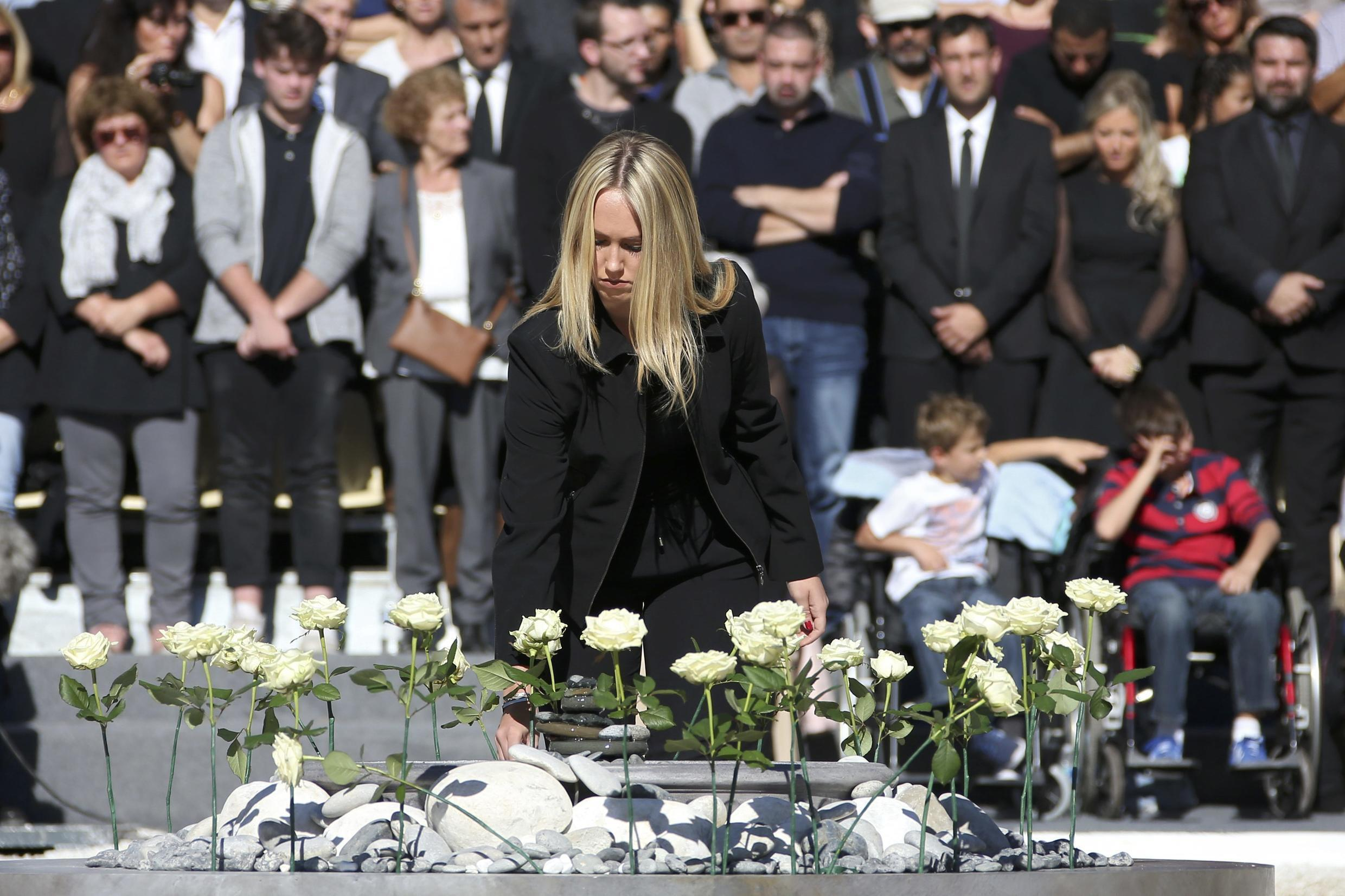 White roses, each representing one of the 86 victims, are put in place during the ceremony in tribute to the victims and the families of the fatal truck attack in Nice on July 14 2016