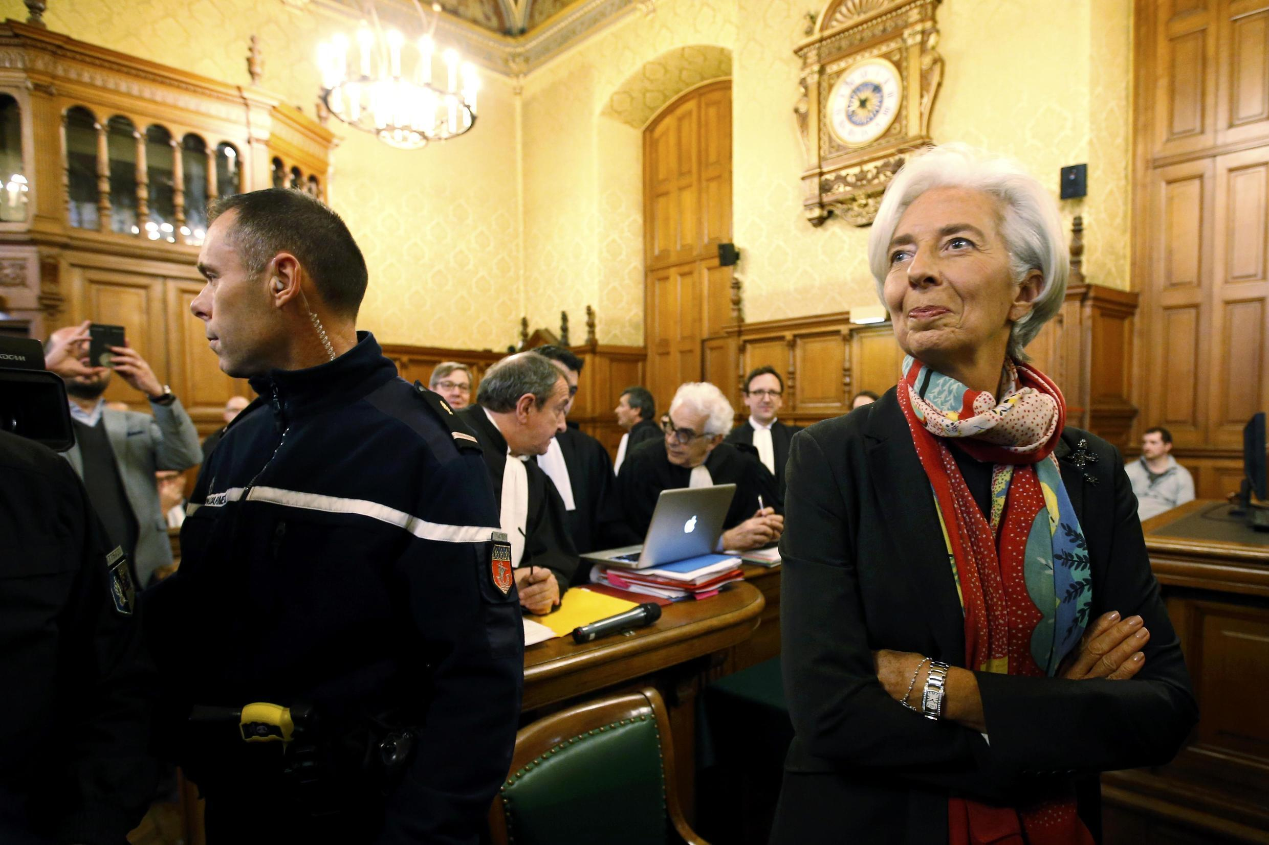 Managing Director of the International Monetary Fund (IMF) Christine Lagarde reacts before the start of her trial about a state payout in 2008 to a French businessman, at the courts in Paris, France, December 12, 2016.