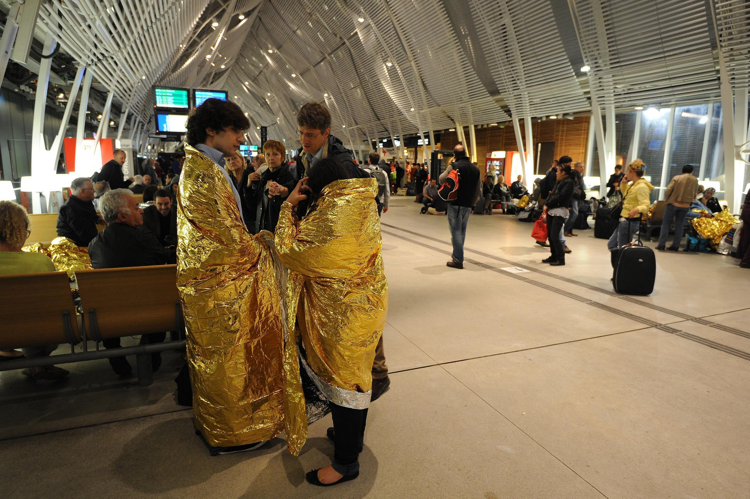 Passengers and local residents take shelter at Montpellier's Saint Roch railway station on Monday night