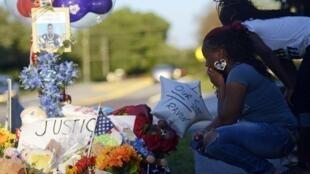 Americanos fazem vigília para protestar contra a morte do jovem Trayvon Martin, na Flórida.