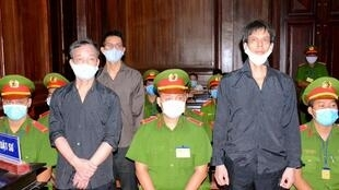 Vietnamese bloggers Pham Chi Dung (R), Nguyen Tuong Thuy (L) and Le Huu Minh Tuan (3rd L) were jailed on anti-state charges on Tuesday