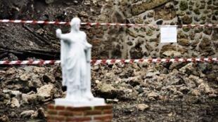 Une vue du mur effondré de la «maison du moraliste», sur le site archéologique de Pompéi. Photo : 30 novembre 2010.
