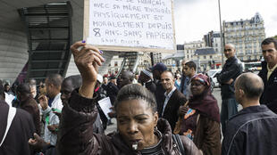 Protesters pushing for legislation that supports migrants of irregular status, les sans-papiers in Paris, 5 October 2013.