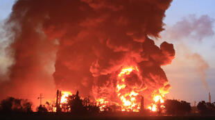 Firefighters are battling to contain the blaze at the refinery in West Java
