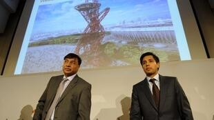 Chairman and CEO Lakshmi Mittal (L) and son at  ArcelorMittal HQ in Luxembourg