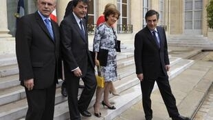 Ministers leave the Elysée Palace after the last cabinet meeting of Sarkozy's presidency