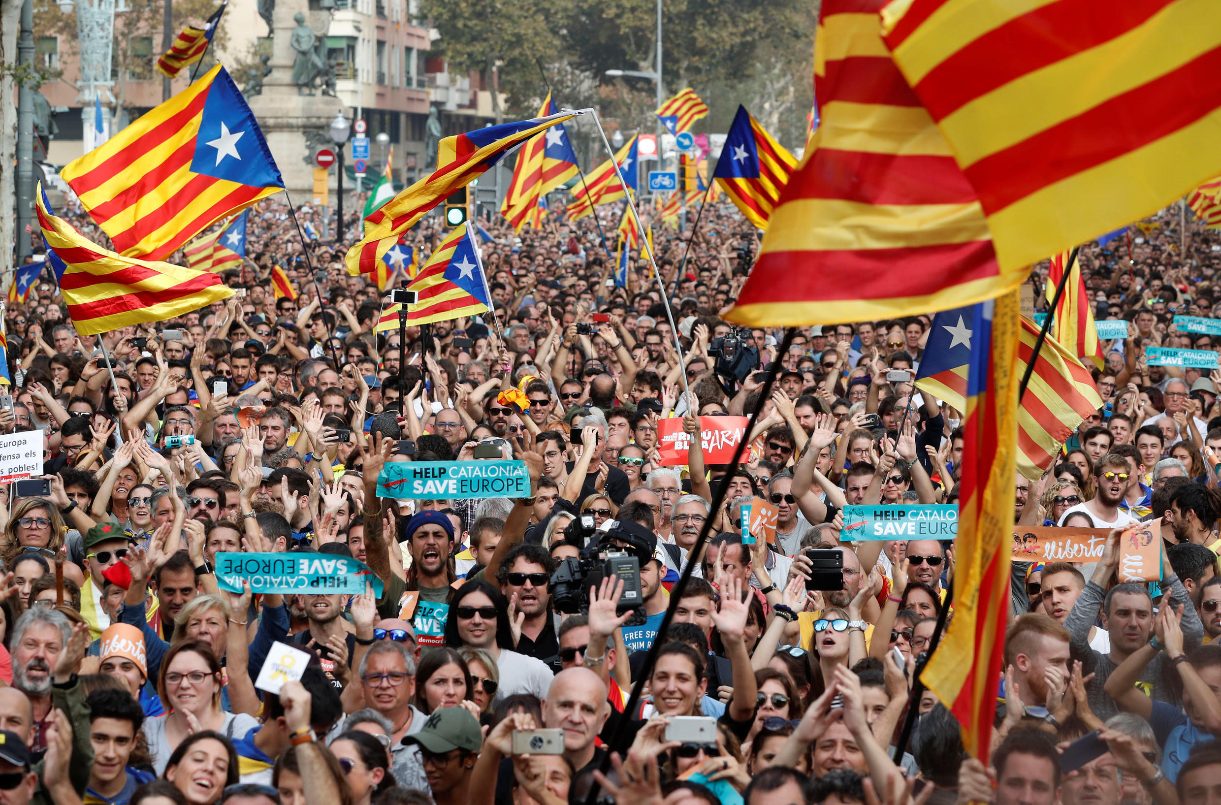 Thousands of demonstrators cheer the independence declaration in Barcelona on Friday