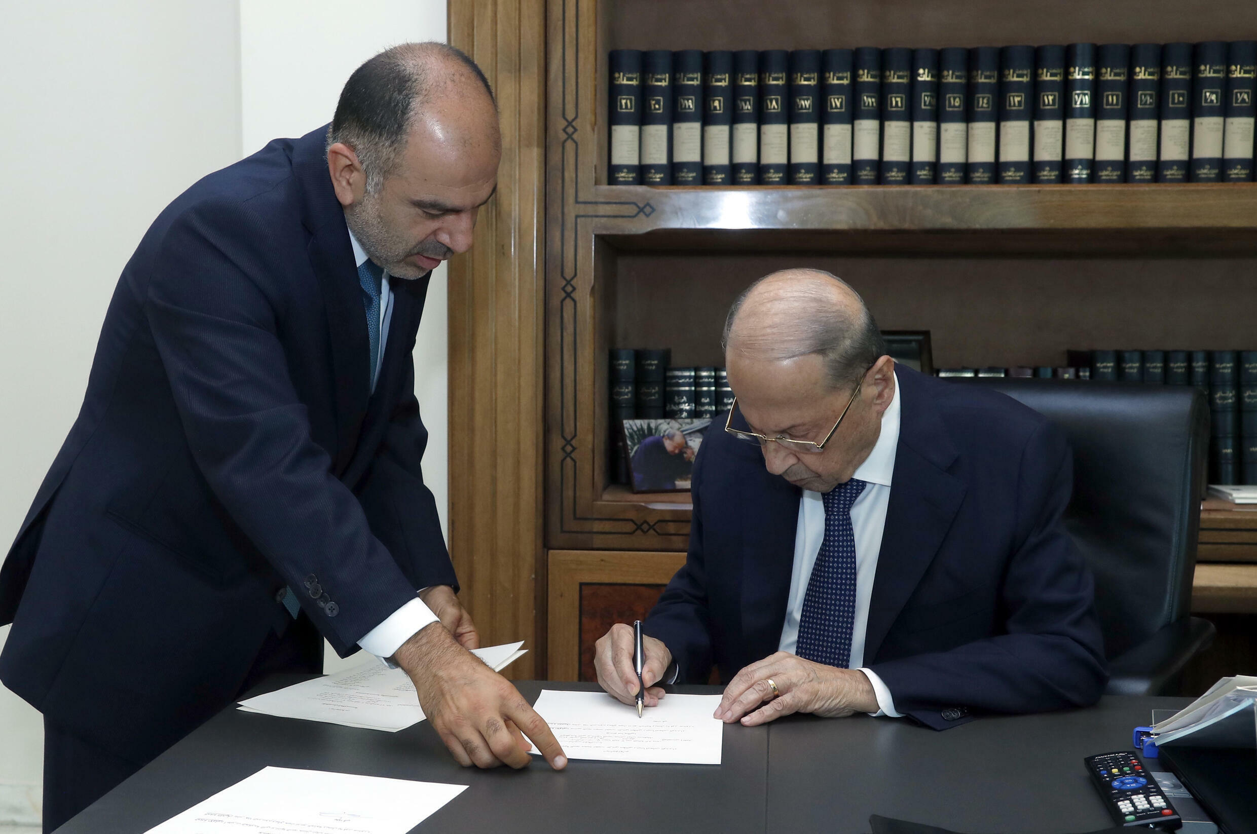 President Michel Aoun signs a decree for the formation of a new Lebanese government after meeting prime minister-designate Najib Mikati