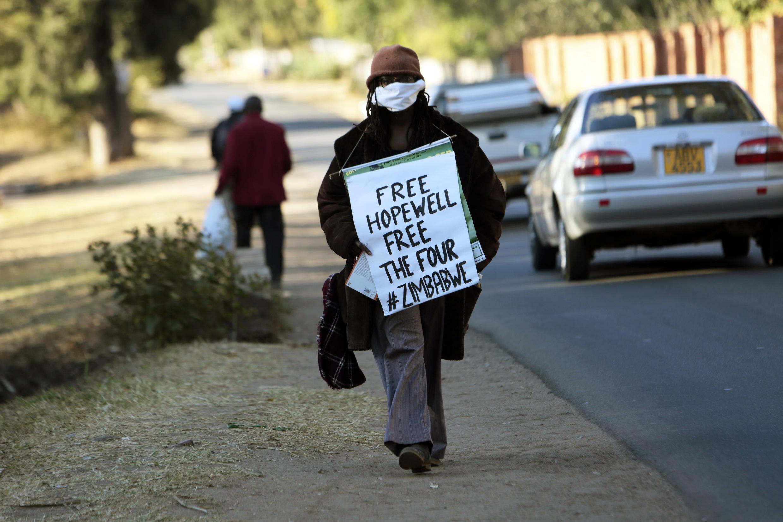 Zimbabwean writer Tsitsi Dangarembwa demonstrates outside Hopwell Chin'ono's house in Harare, Monday, 20 July, 2020.