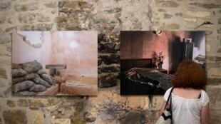 L'exposition «Une colonne de fumée» au festival «Les rencotnres de la photographie - Arles 2018» le 3 juillet 2018.