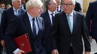 British Prime Minister Boris Johnson and European Commission President Jean-Claude Juncker leave after their meeting in Luxembourg, September 16, 2019.