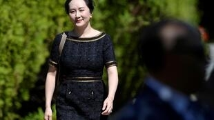 La numéro deux de Huawei, Meng Wanzhou, quitte son domicile pour se présenter à la cour de justice, à Vancourver, le 27 mai 2020.