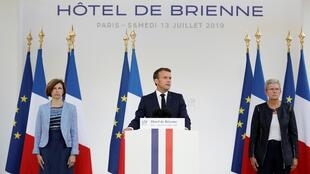 French President Emmanuel Macron speaks at the residence of French Defense Minister on the eve of Bastille Day in Paris, 13 July 2019.