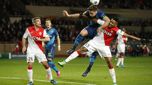 Arsenal and Monaco players in action during their round of 16 encounter.