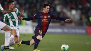 Lionel Messi trong màu áo của Barcelona tại trận tranh Cúp Nhà vua Tây Ban Nha ngày 12/12/2012.