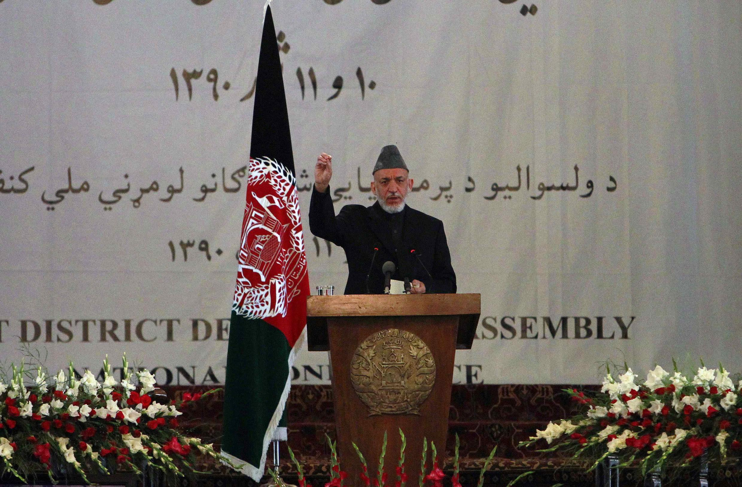 Afghan President Hamid Karzai called on the Taliban not to react violently to bin Laden's death