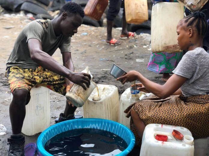 Hawa Kiazolu and brother Aaron Kiazolu on the banks of the Mesurado River, Monrovia Liberia,
