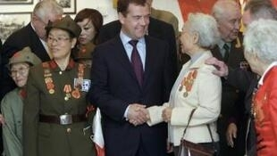 Russian President Dmitry Medvedev meets Chinese World War II veterans in the area of Lushun