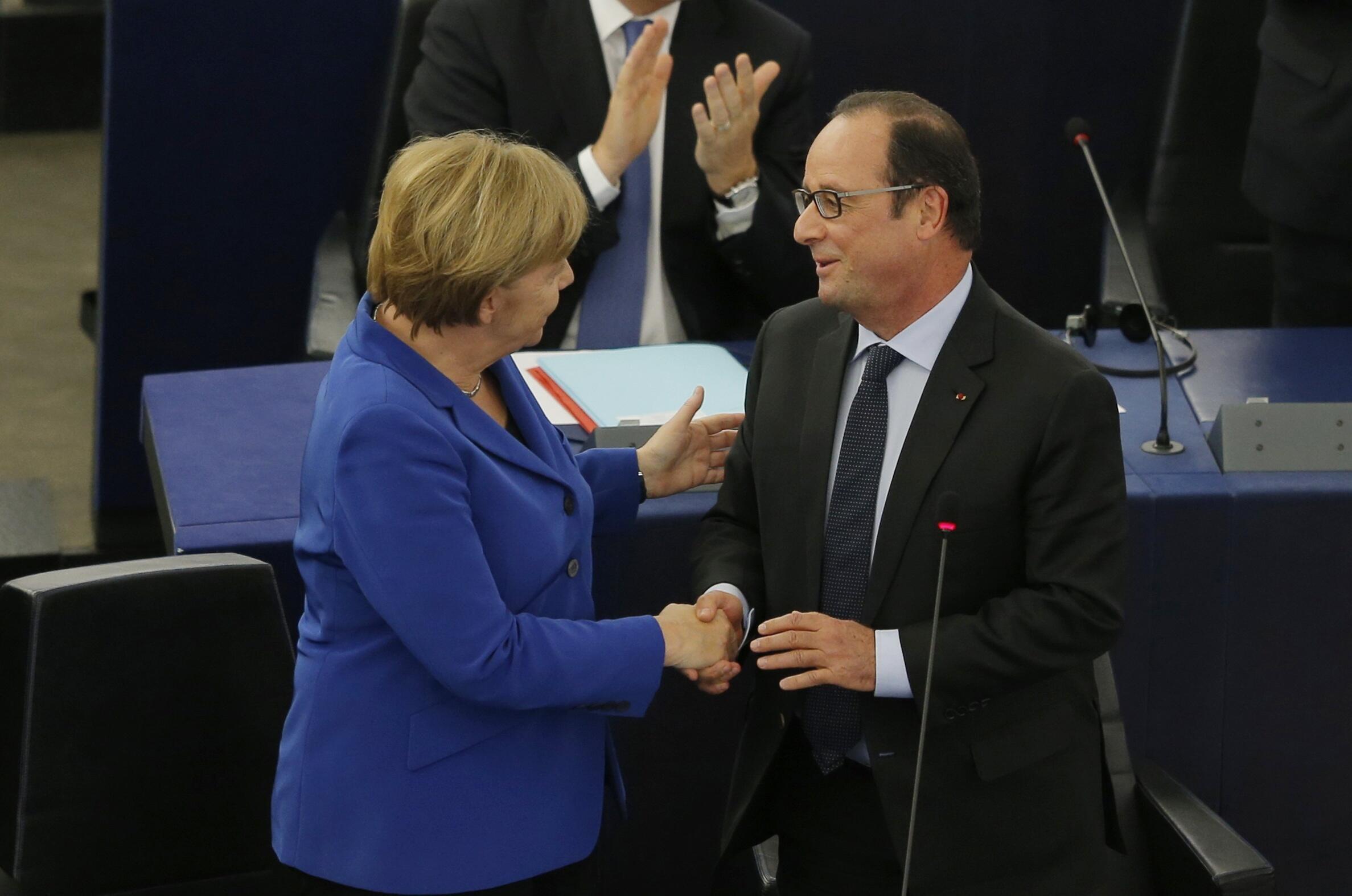 Angela Merkel e François Hollande, a 7 de Outubro de 2015 no Parlamento europeu  em Estrasbourg.