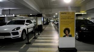 Cars sit idle at the Hertz Rent-A-Car rental lot at San Francisco International Airport in California on April 30, 2020. Hertz says it has filed for bankruptcy in the US and Canada