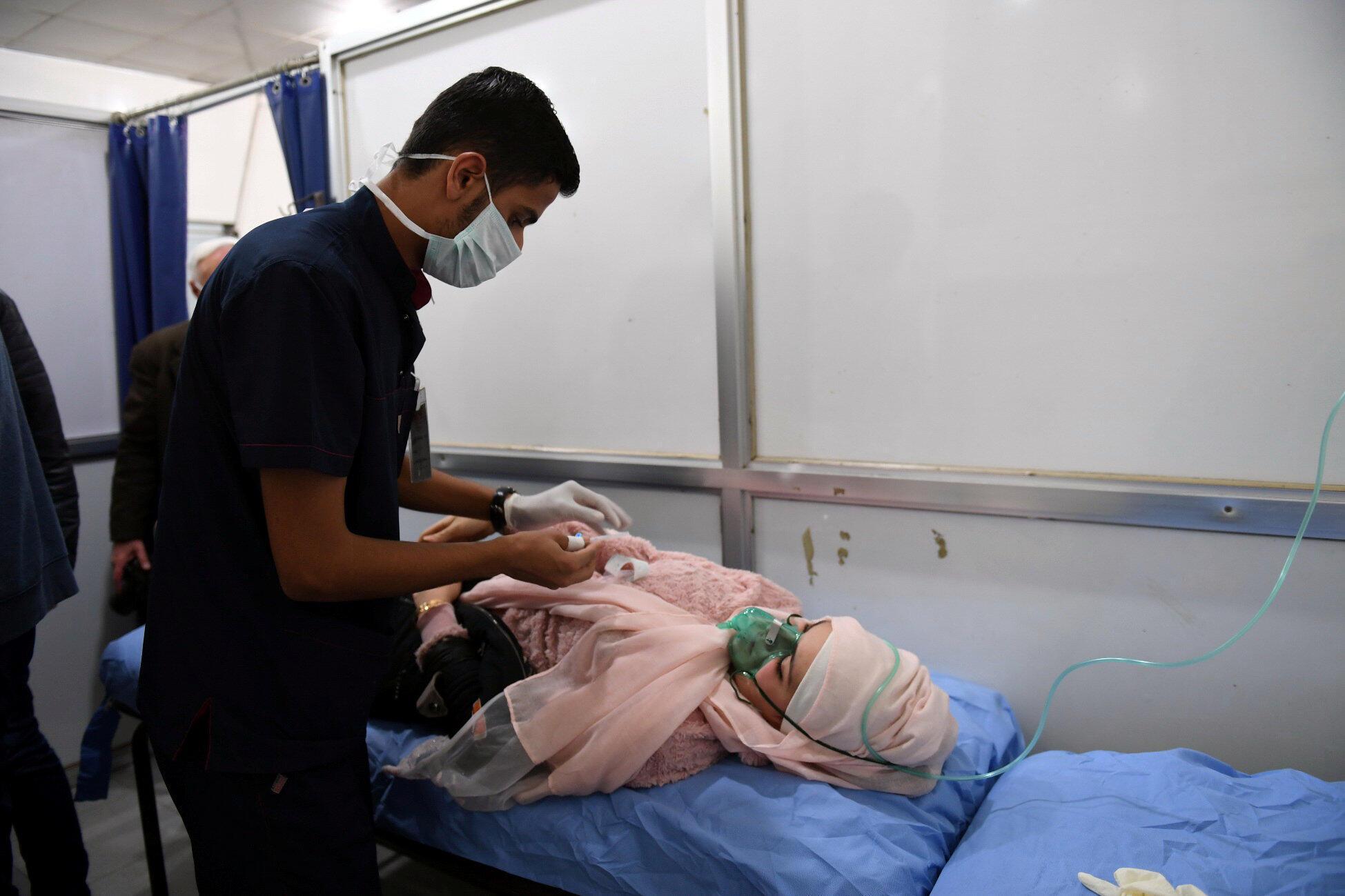 Государственное агентство SANA распространило фотографии мирных жителей, пострадавших от вероятной химической атаки