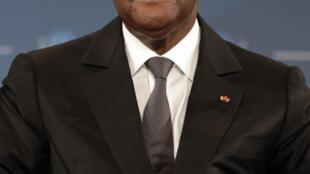 Le président Alassane Ouattara, lors d'une conférence à Cannes en décembre 2012.