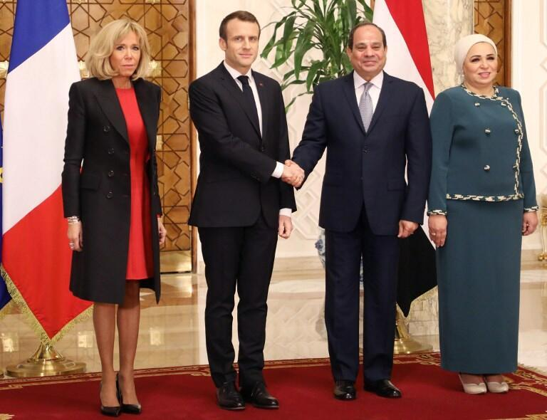 Emmanuel Macron and wife Brigitte Macron are welcomed by Abdel Fattah al-Sissi and Intissar Amer at the presidential palace in Cairo on 28 January 2019.