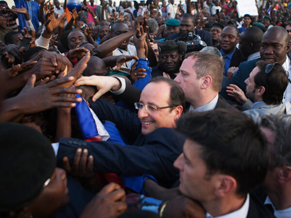 Francois Hollande greets a cheering crowd at Independence Plaza in Bamako on 2 February, 2013