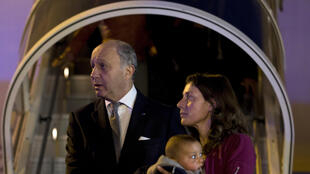 French Foreign Affairs Minister Laurent Fabius greets survivors of Nepal's earthquake at Paris's Charles De Gaulle airport