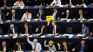 Democracy in action: members of the European Parliament take part in a voting session.