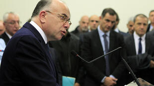 French interior minister Bernard Cazeneuve (L) speaks during a press conference during a visit to Ajaccio on December 30, 2015 on the French Mediterranean island of Corsica