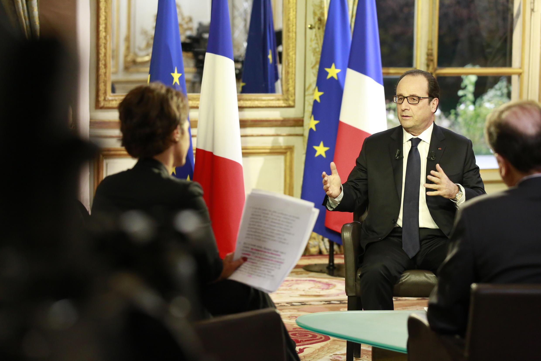 François Hollande faces journalists from RFI, France 24 and TV5 at the Palais de l'Elysée on Thursday evening