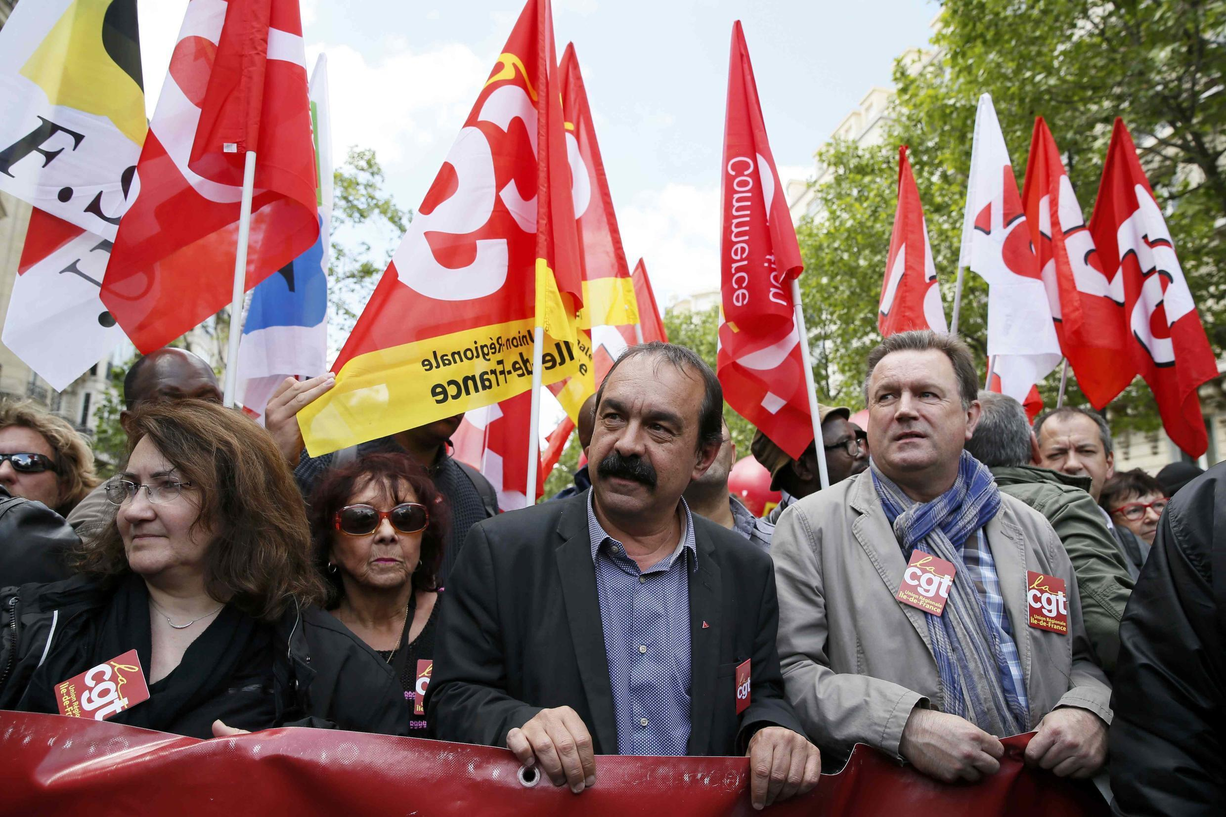 French CGT trade union general secretary Philippe Martinez (C) attends a demonstration against French labour law reforms in Paris, France, May 17, 2016.