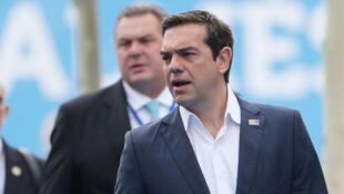 Le pRemier ministre grec Alexis Tsipras, à Bruxelles pour le sommet de l'Otan, le 12 juillet 2018. Réuni à Bruxelles, l'Eurogroupe précise les conditions de sortie de la Grèce du plan d'aide.