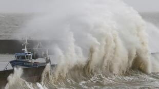 Waves crash on the protecting wall at the fishing harbour in Pornic as stormy weather with high winds hits the French Atlantic coast on 8 February, 2016.