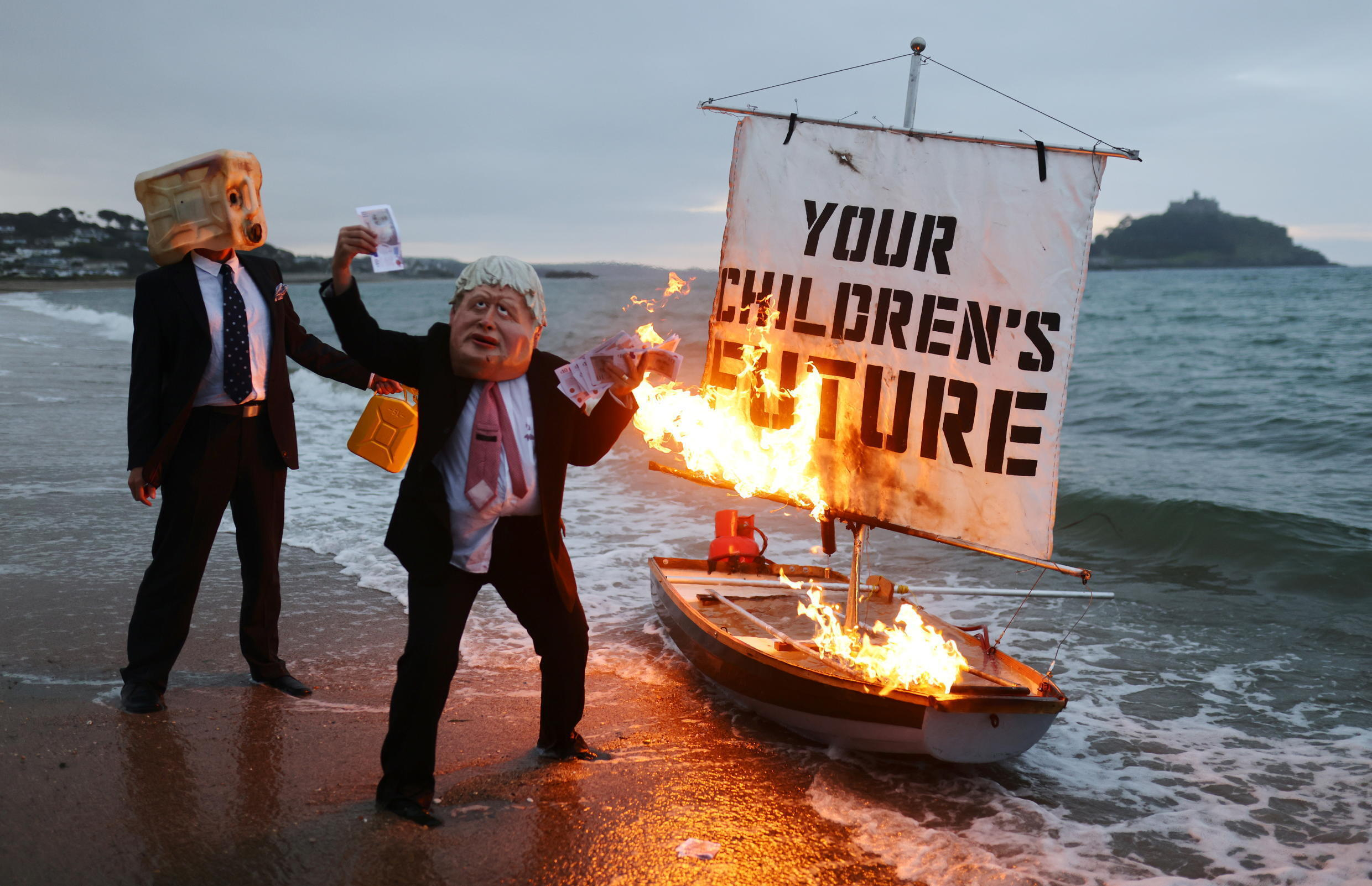 Activists from climate action group Ocean Rebellion_Cornwall_UK_5 June 2021_Tom Nicholson_Reuters