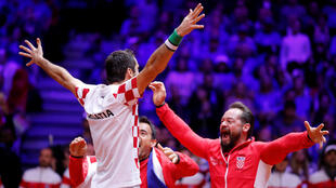 Croatia Davis Cup captain Zeljko Krajan (right) was among the first to congratulate Marin Cilic after he won Croatia's third point in the 2018 Davis Cup final.n Croati