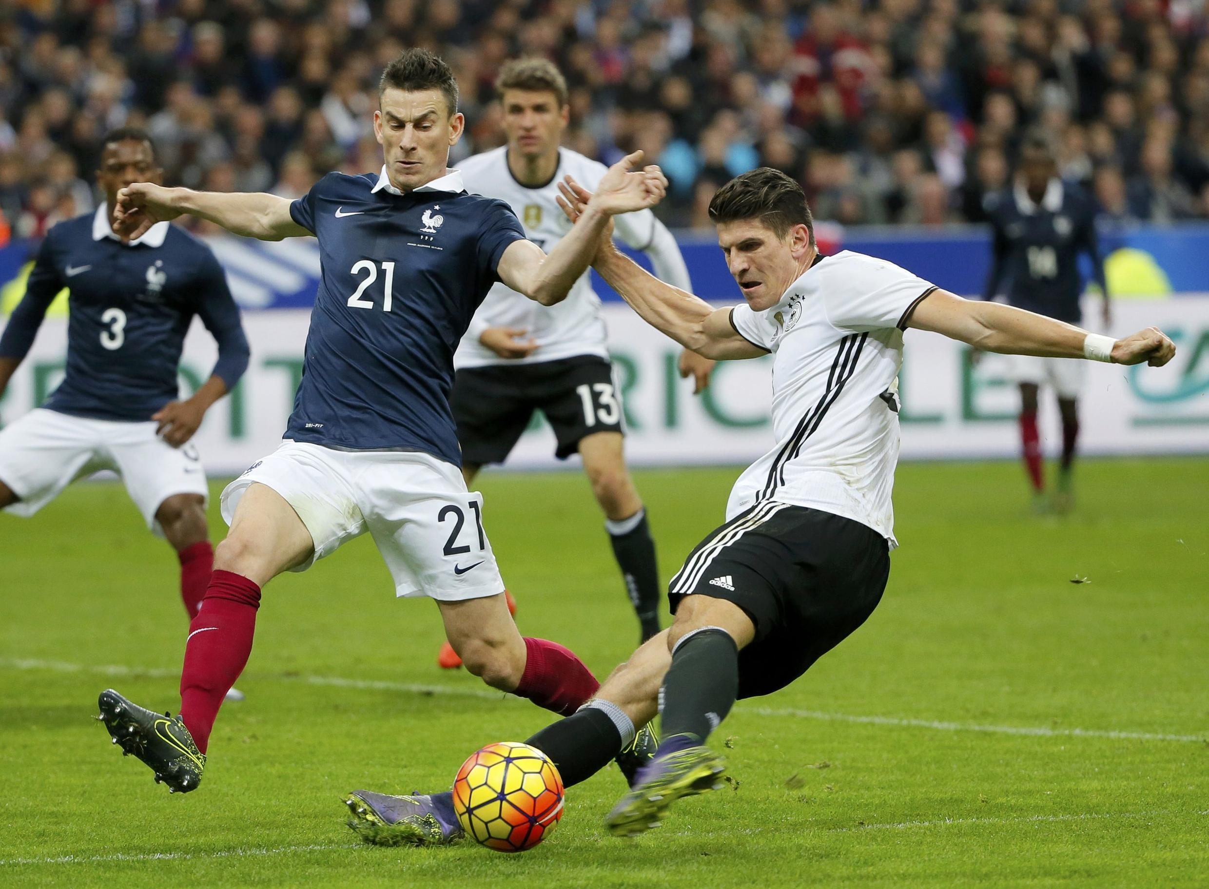 France's Laurent Koscielny in action with Germany's Mario Gomez during the France-Germany friendly at Stade de France on 13 November, 2015
