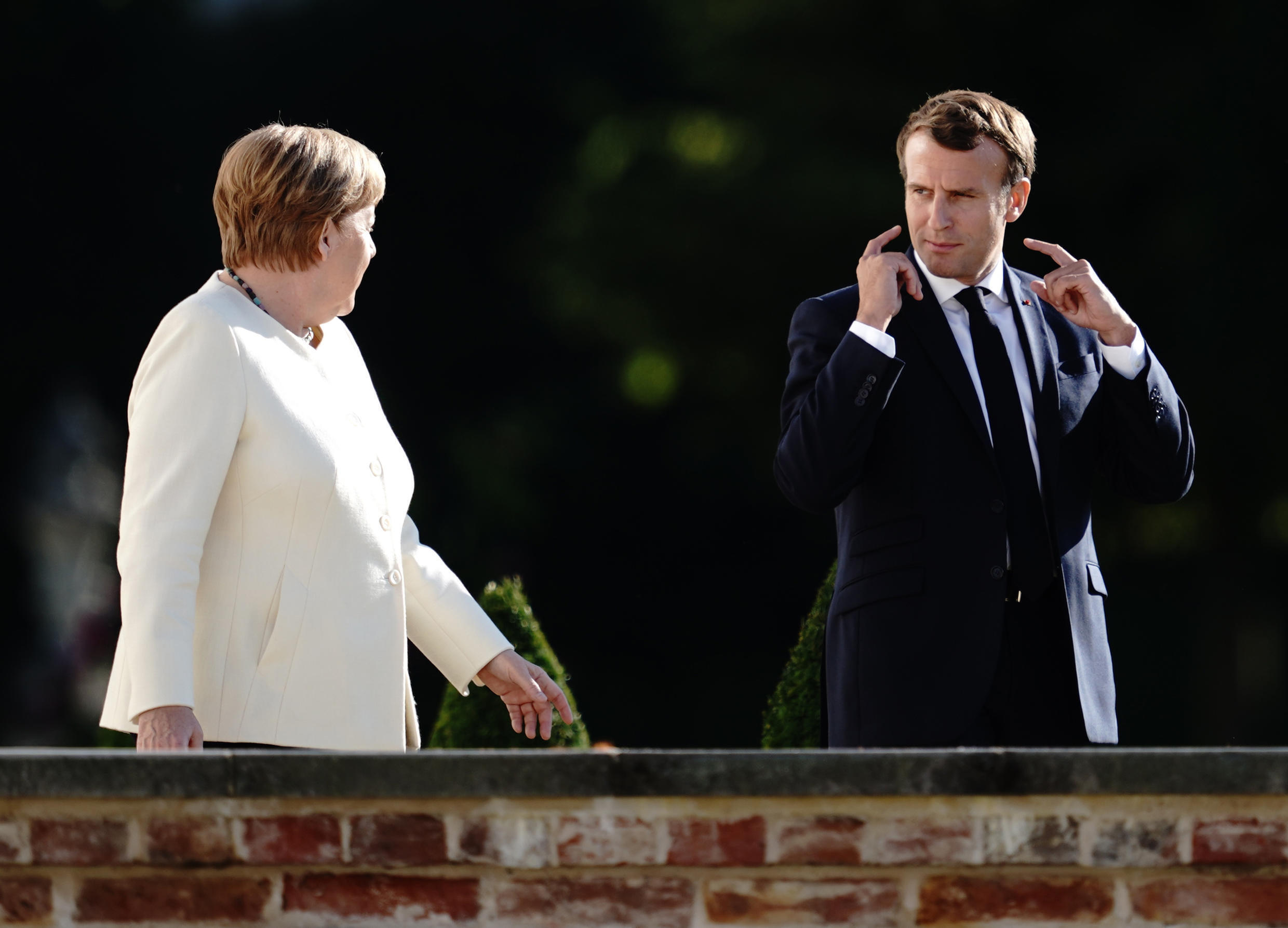 German Chancellor Angela Merkel and French President Emmanuel Macron arrive to give a press conference following a meeting on 29 June 2020 in Meseberg.