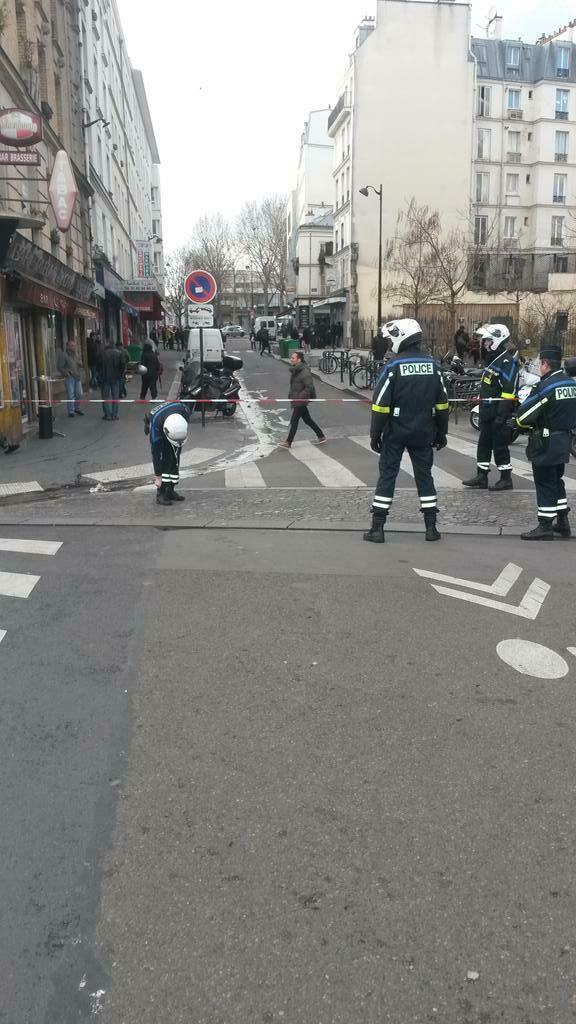 Police block Rue de Jessaint in Paris after a man armed with a meat cleaver and a fake suicide vest was shot dead, 7 January
