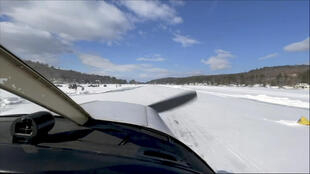 Pilot Scott Bahan in a Piper Cherokee small plane as it taxis to the icy runway in Alton, New Hampshire on Lake Winnipesaukee