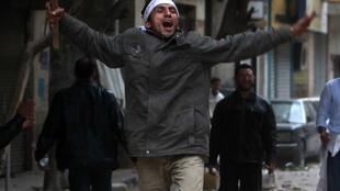 An anti-government protester celebrates after hearing a rumour that Mubarak will resign