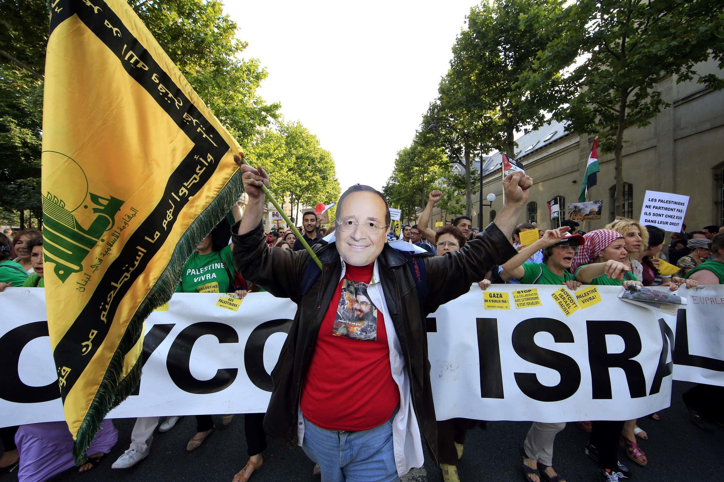 Protesters mock French President François Hollande's stance on the Gaza conflict this week
