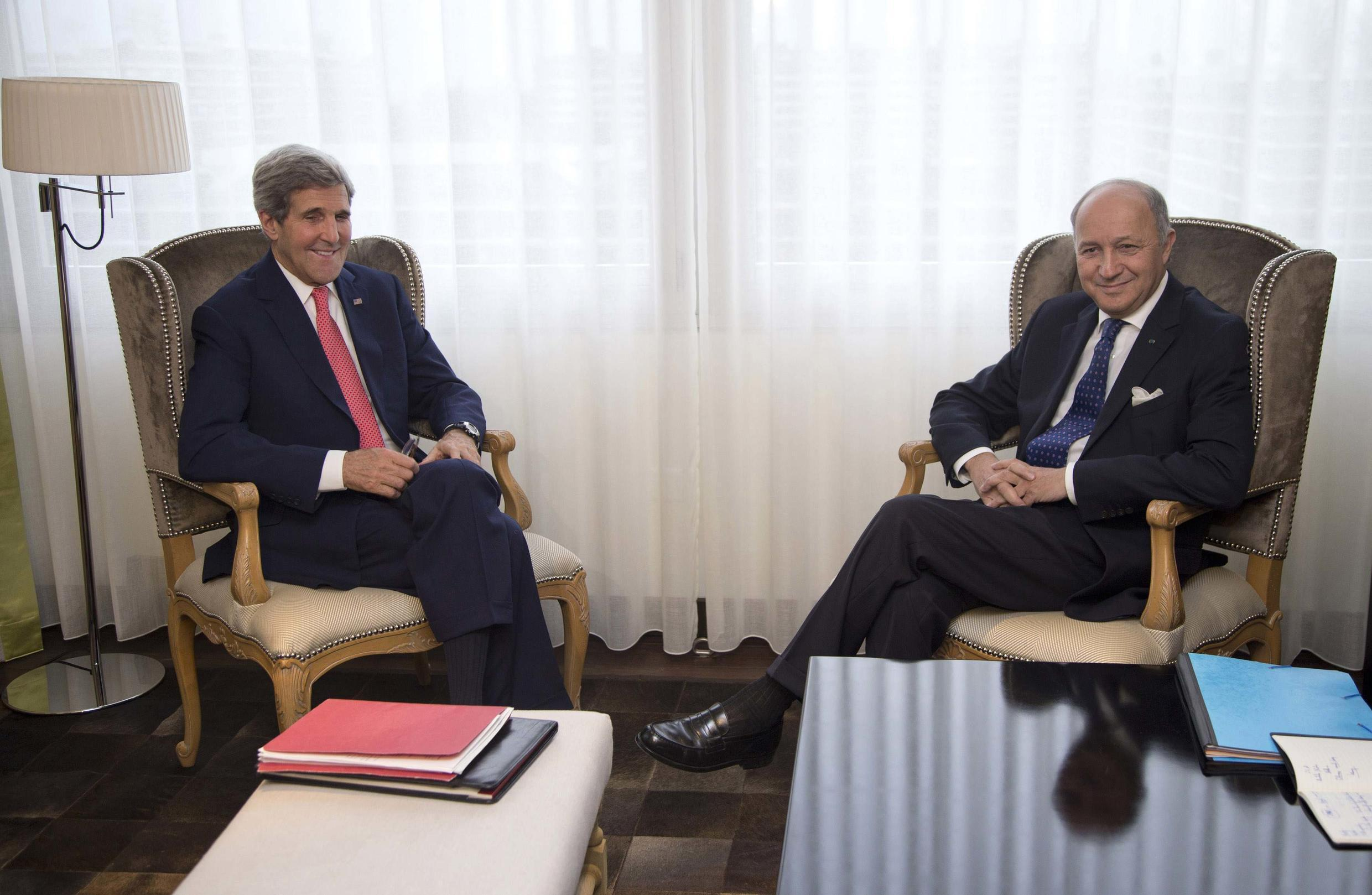 U.S. Secretary of State John Kerry and French Foreign Minister Laurent Fabius meeting ahead of Iran nuclear talks in Geneva on November 23.