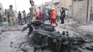 Lực lượng an ninh Irak trên hiện trường vụ khủng bố ở Bassora, (miền nam), ngày 14/07/2013